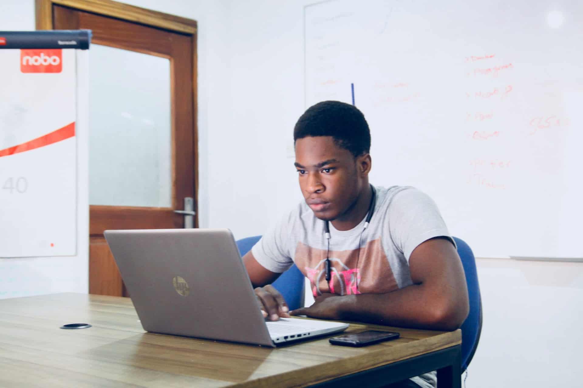 man working rendering laptop